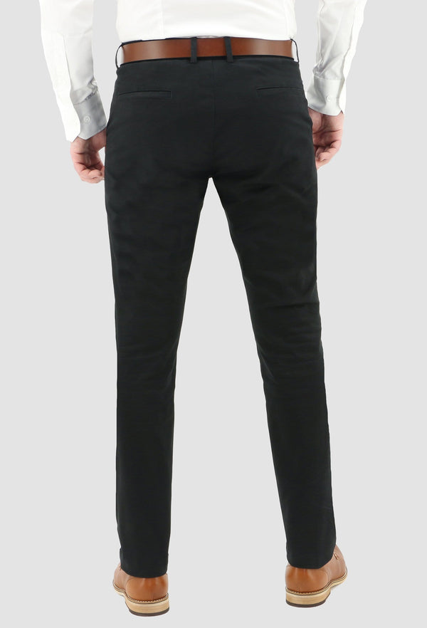a model faces the back wearing the daniel hechter slim fit chino in black cotton blend