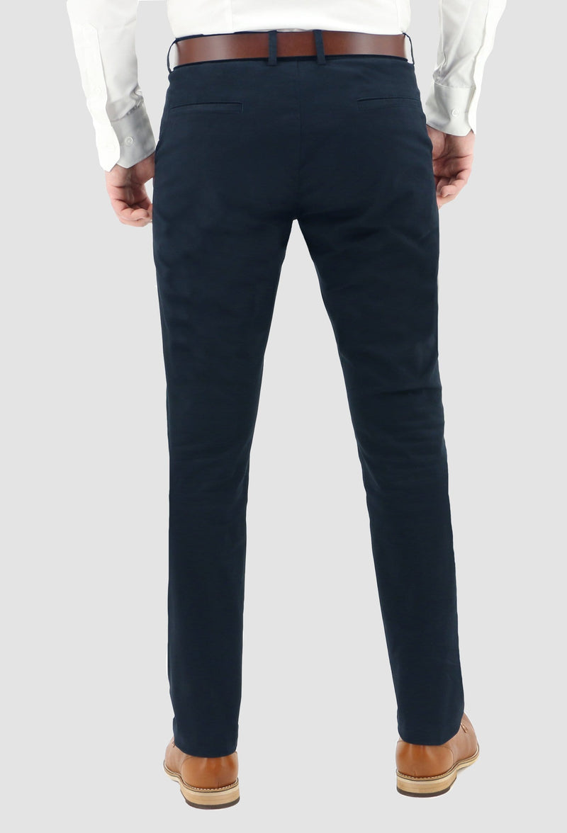 the rear view of the daniel hechter slim fit navy cotton stretch chinos worn with a white shirt and a tan leather shoe