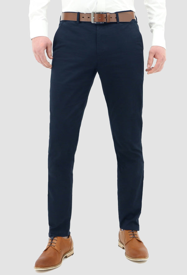 a front on view of the daniel hechter slim fit navy cotton stretch chinos worn with a white shirt and a tan leather shoe