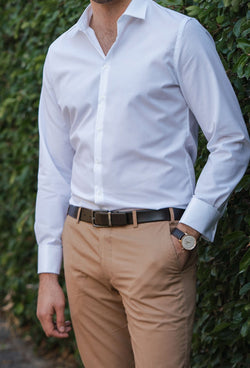 STDS595 Daniel Hechter slim fit shape business suit in white pure cotton worn by a model with a brown belt and sand coloured chino
