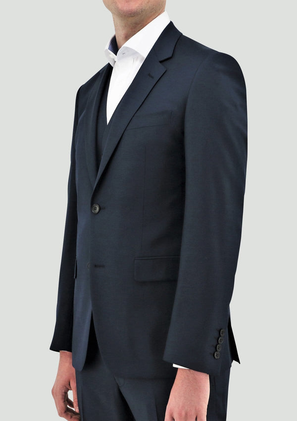a front view of the daniel hechter slim fit ryan mens suit vest in deep blue merino wool STDH106-14 layered under the shape mens suit jacket in blue