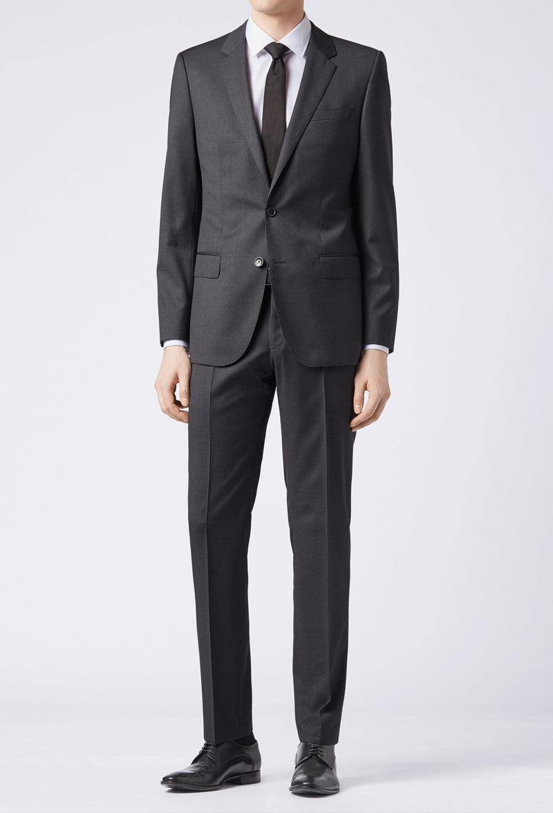 a full length view of a Hugo Boss slim fit heyes suit in dark grey pure wool HB50318498-021