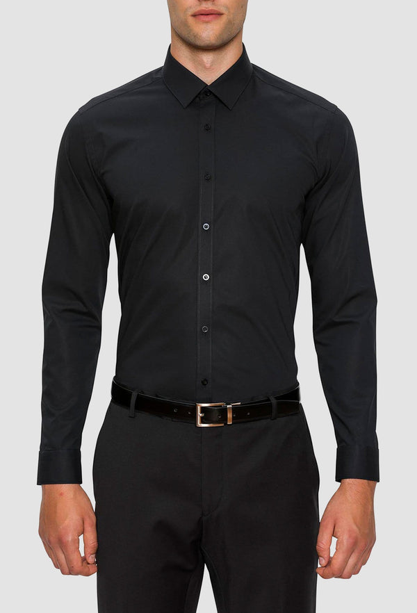 A model wears the Gibson slim fit fierce shirt in black FGC054 styled with a black belt and pant for an evening look