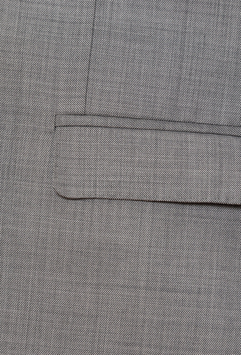 A close up view of the flat pocket detailing on the Gibson slim fit lithium suit jacket in grey pure wool FGE645