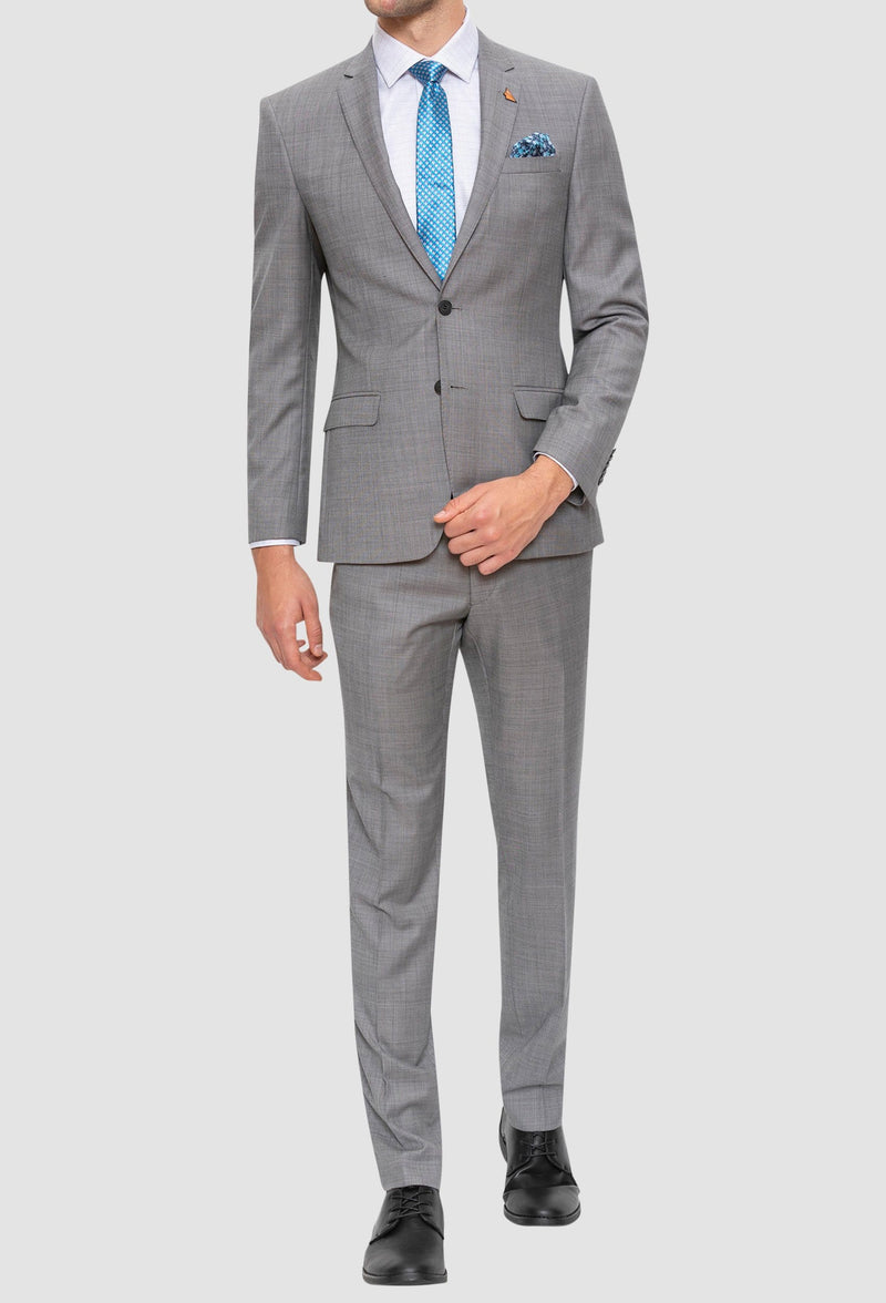 A full length up view of the Gibson slim fit lithium suit in grey pure wool FGE645 styled with a white shirt and blue tie