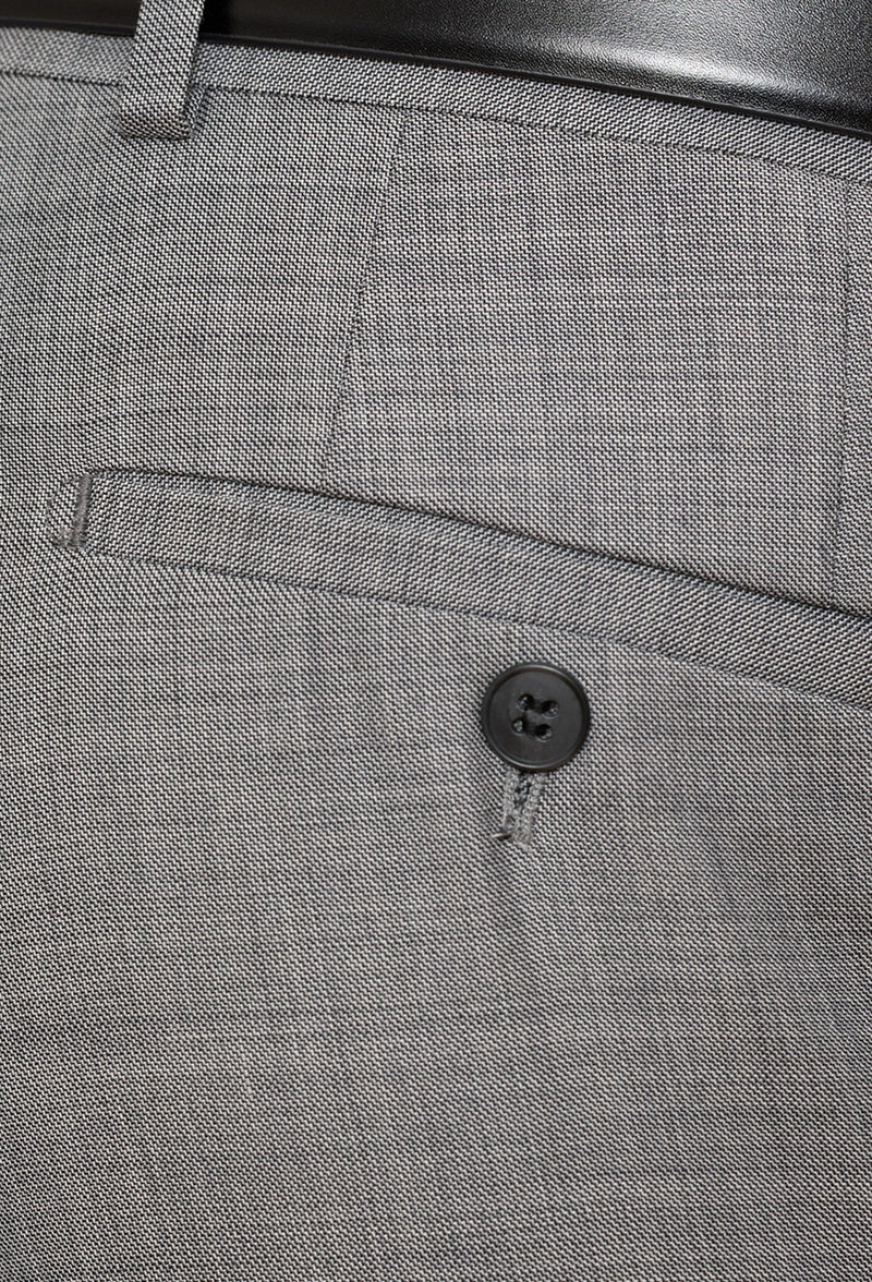 A close up view of the rear hip pocket detail on the Gibson slim fit lithium suit trouser in grey pure wool FGE645