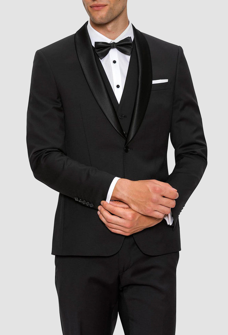 A close view of the satin shawl lapel on the Gibson slim fit spectre evening suit jacket in black pure wool F34087