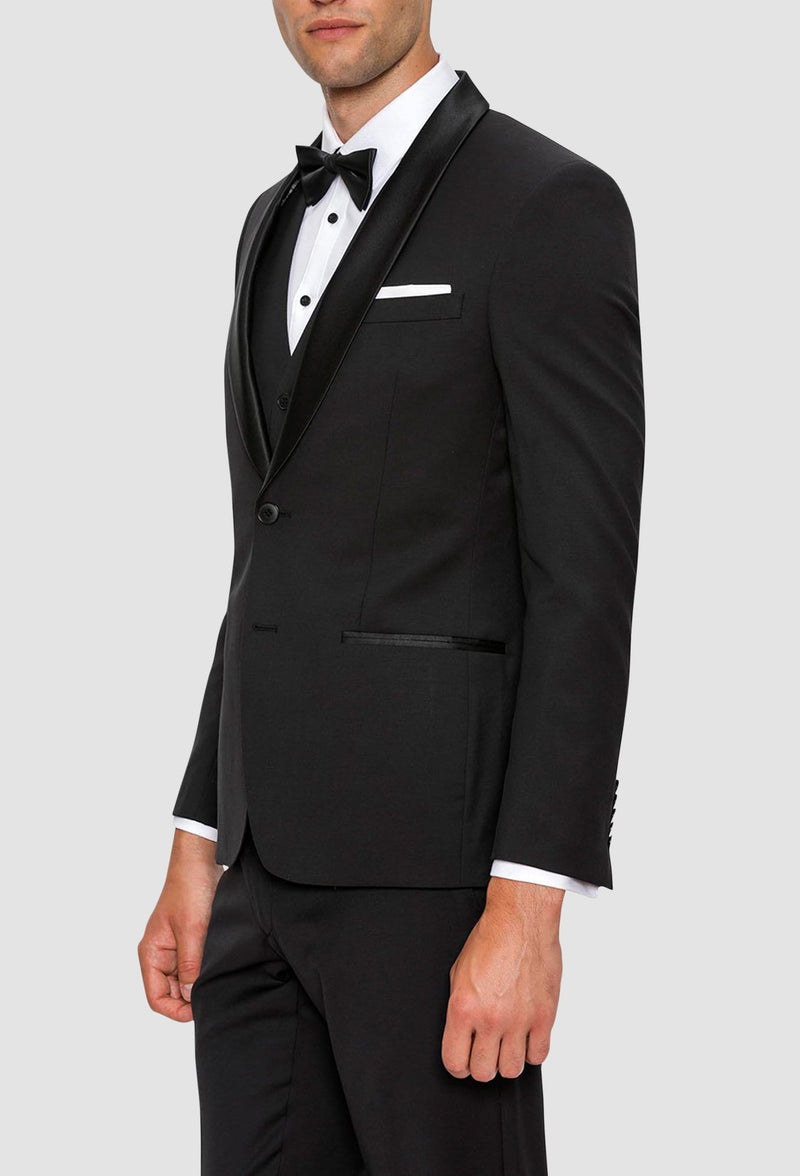 A side view of theGibson slim fit spectre evening suit in black pure wool F34087