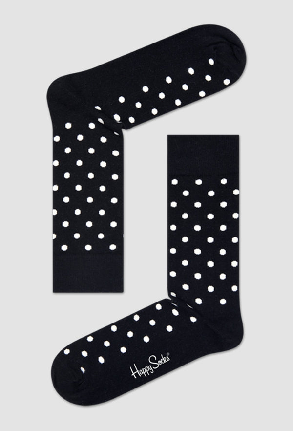 a pair of the Happy Socks dot sock in black and white laid out on a grey background