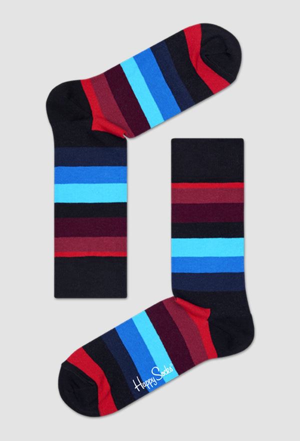 a pair of happy socks stripe socks in black red and blue cotton laid out on a grey background