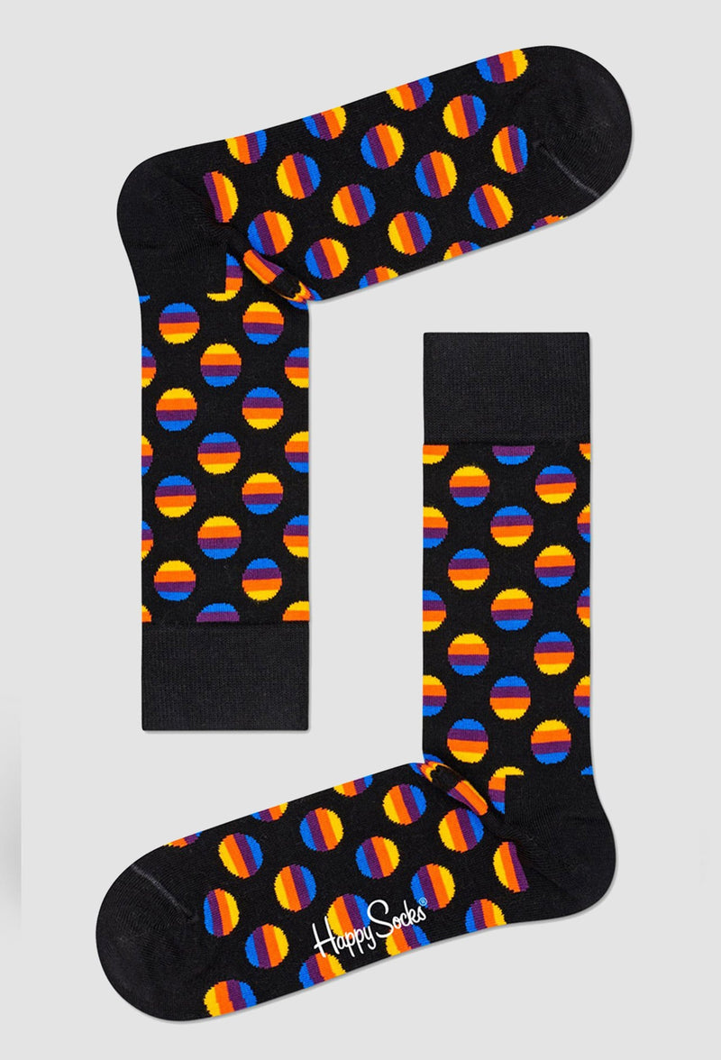 a pair of happy socks sunrise dots sock in black combed cotton against a plain grey background