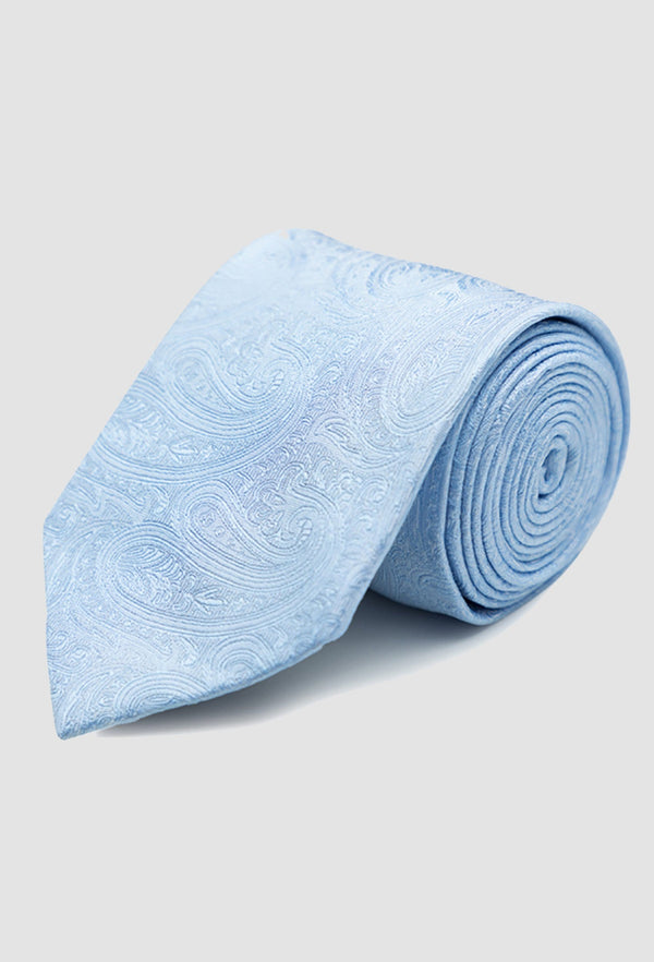 Joe Black paisley jacquard tie in sky PJAF000017 rolled up on a grey background