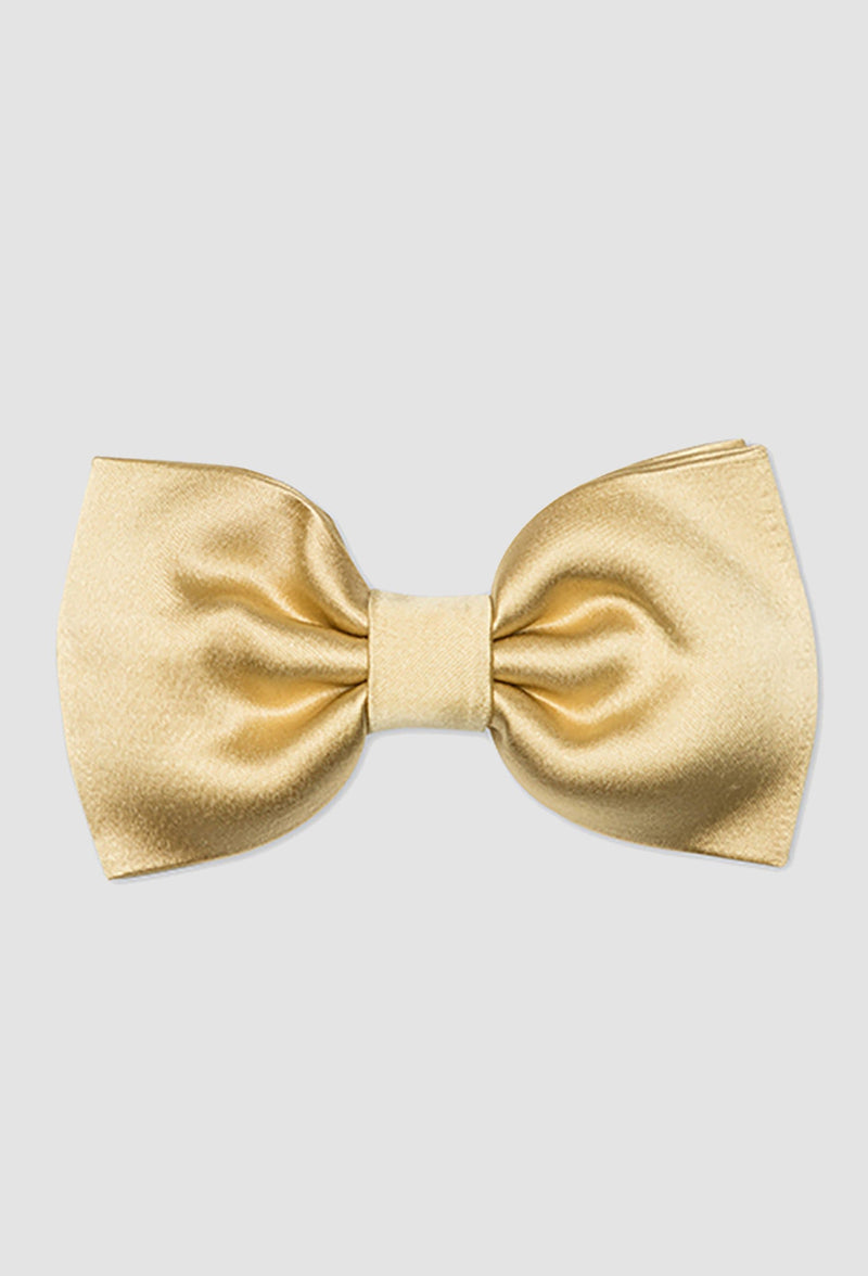A close up view of the Joe Black classic bow tie in gold PJAY000044 on a grey background