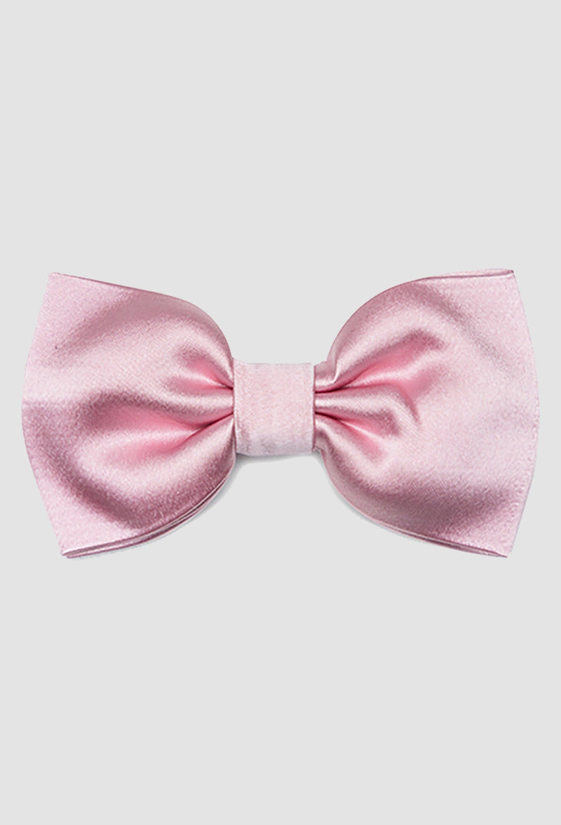 A close up view of the Joe Black classic bow tie in pink PJAY000044 on a grey background