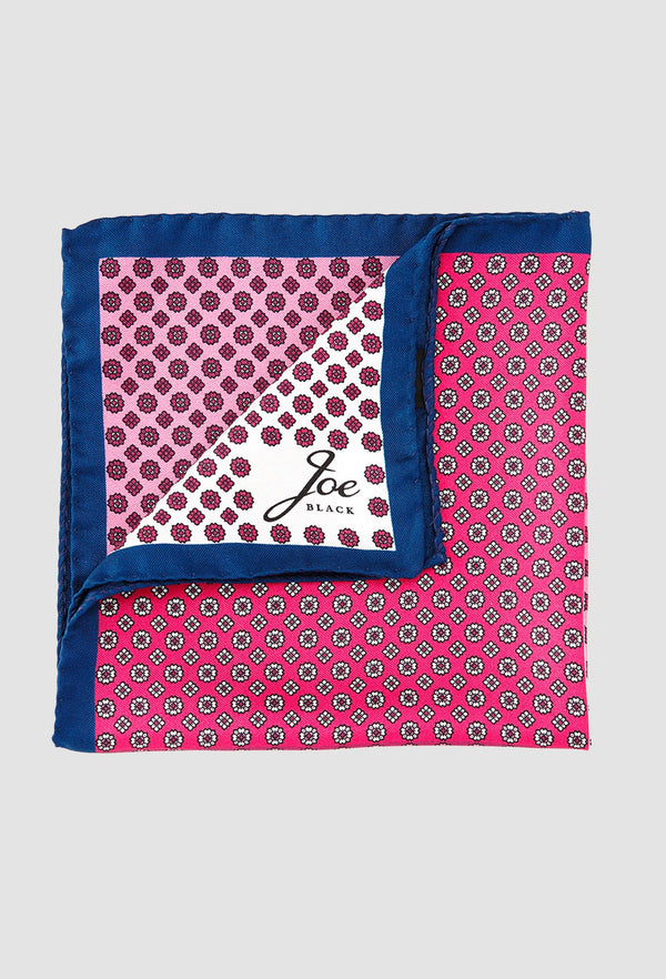 a close up of the Joe Black four way foulard pochette in pink silk PJAF000016 folded on a grey background