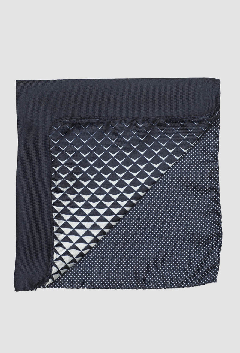 a close up of the Joe Black four way geometric pochette in navy silk PJAF000019 folded onto a grey background