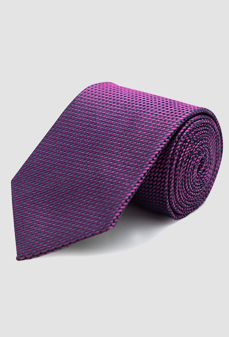 Joe Black classic longstitch knot tie in pink PJAE000001 rolled up on a grey background