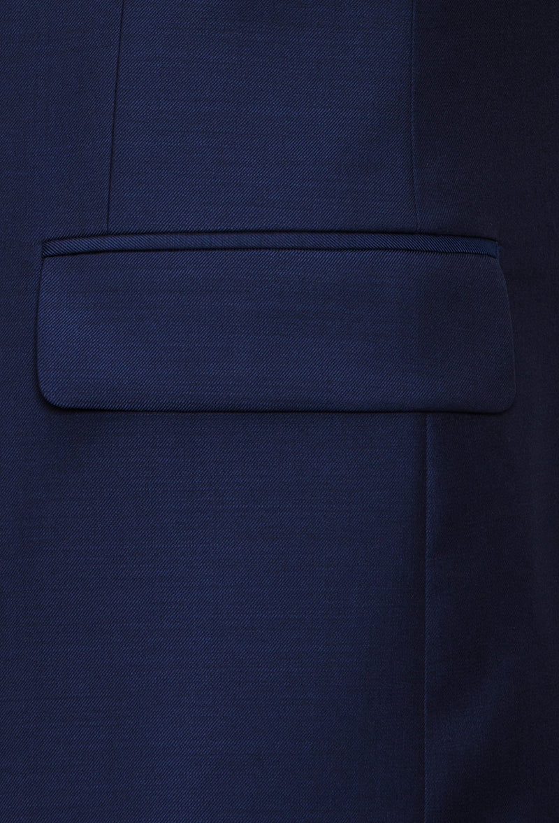A close up view of the Joe Black slim fit anchor suit jacket pocket in navy pure wool FJY100