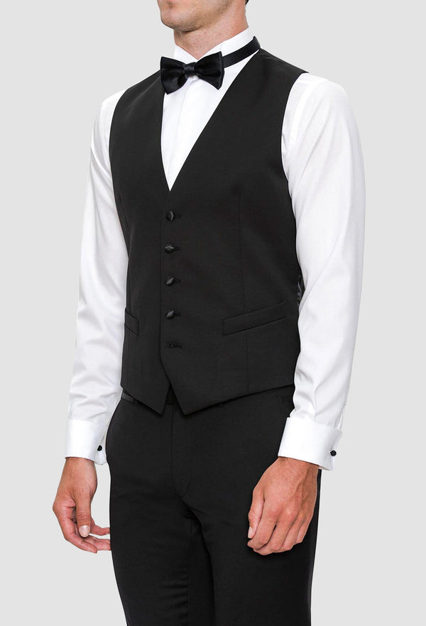 a model wears the joe black slim fit mail vest in black pure wool