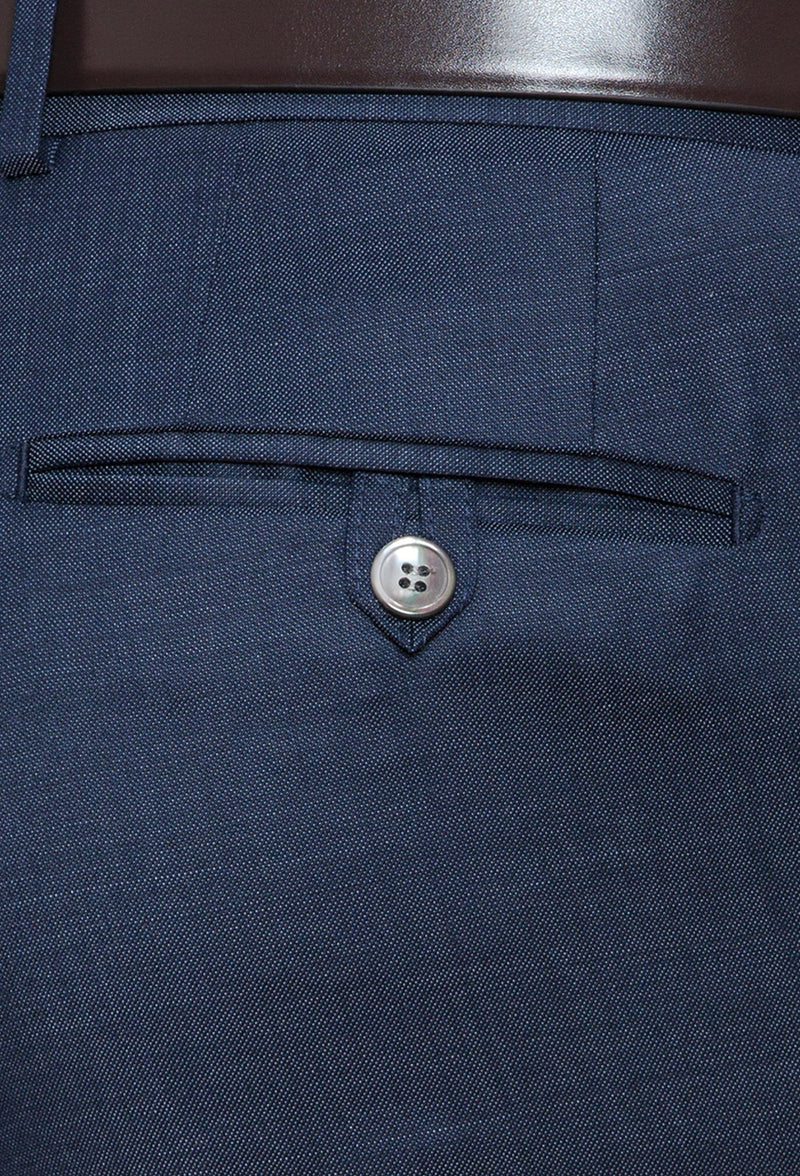 a close up view of the rear hip pocket details on the Joe Black slim fit razor trouser in blue pure wool
