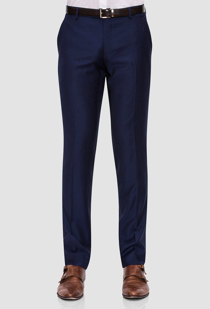 A close up view of the Joe Black slim fit anchor suit trouser in navy pure wool FJY100 styled with a  brown belt