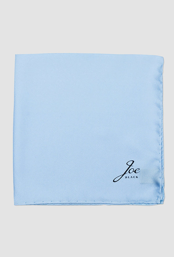 Joe Black classic twill pochette in sky blue silk PJAB000014 folded onto a grey background