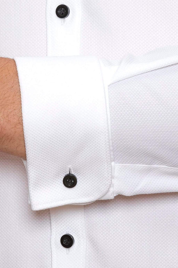 a close up of the joe black slim fit pioneer evening shirt with black contrast buttons and a textured white cotton