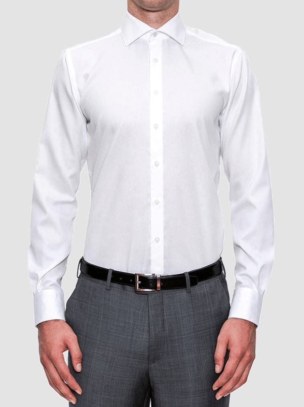 a model wears the preston shirt by cambridge clothing, a crisp 8 button front white business shirt with long sleeves and regular cuffs.