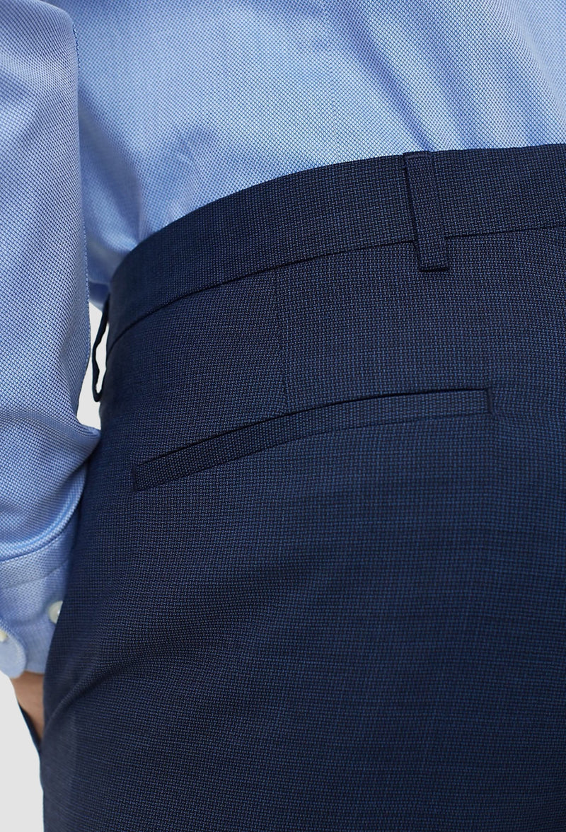 a close up view of the reverse pocket detailing on the Tommy Hilfiger slim fit virgin wool trouser in navy blue