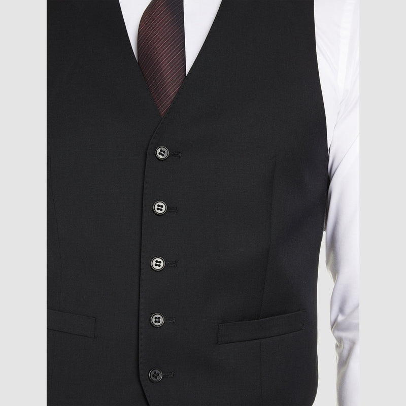 the pocket and button detailing on the classic icon fit alex vest by studio italia in black wool ST-470-31