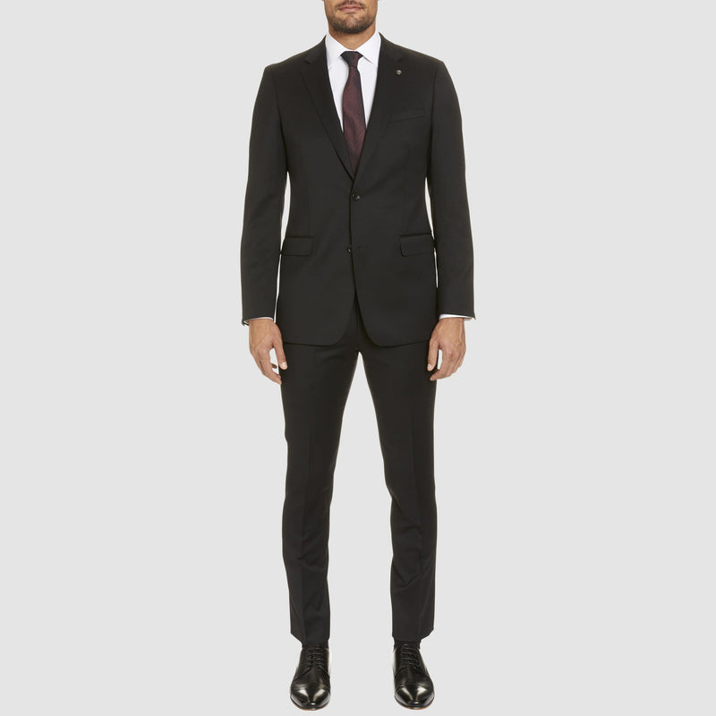 a full length view of the studio italia classic fit icon T81 trouser in black wool blend ST-470-31