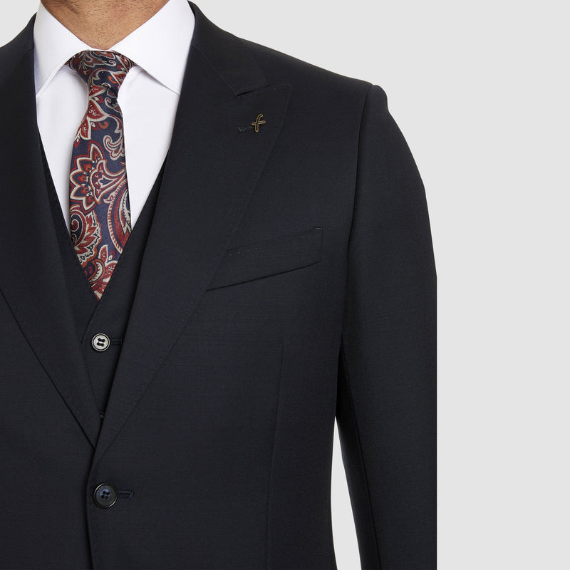 the peak lapel detail of a front view of the studio italia slim fit lugano suit in navy pure wool ST-362-11