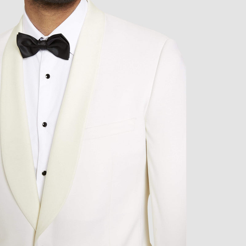 A close up view of the shawl lapel collar on the a front view of the studio italia slim fit prince shawl collar tuxedo jacket ST-436-81 in ivory