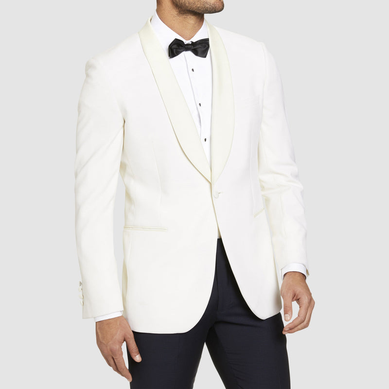 a front view of the studio italia slim fit prince shawl collar tuxedo jacket ST-436-81 in ivory  styled with a black trouser and dinner shirt