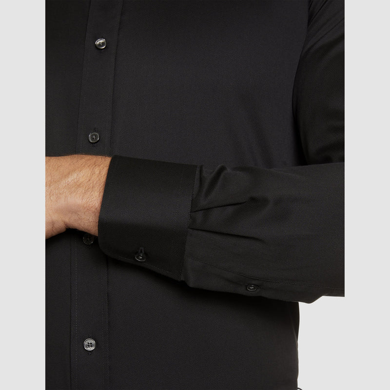 a close up view of the single cuff on the studio italia slim fit spencer business shirt in black easy iron cotton