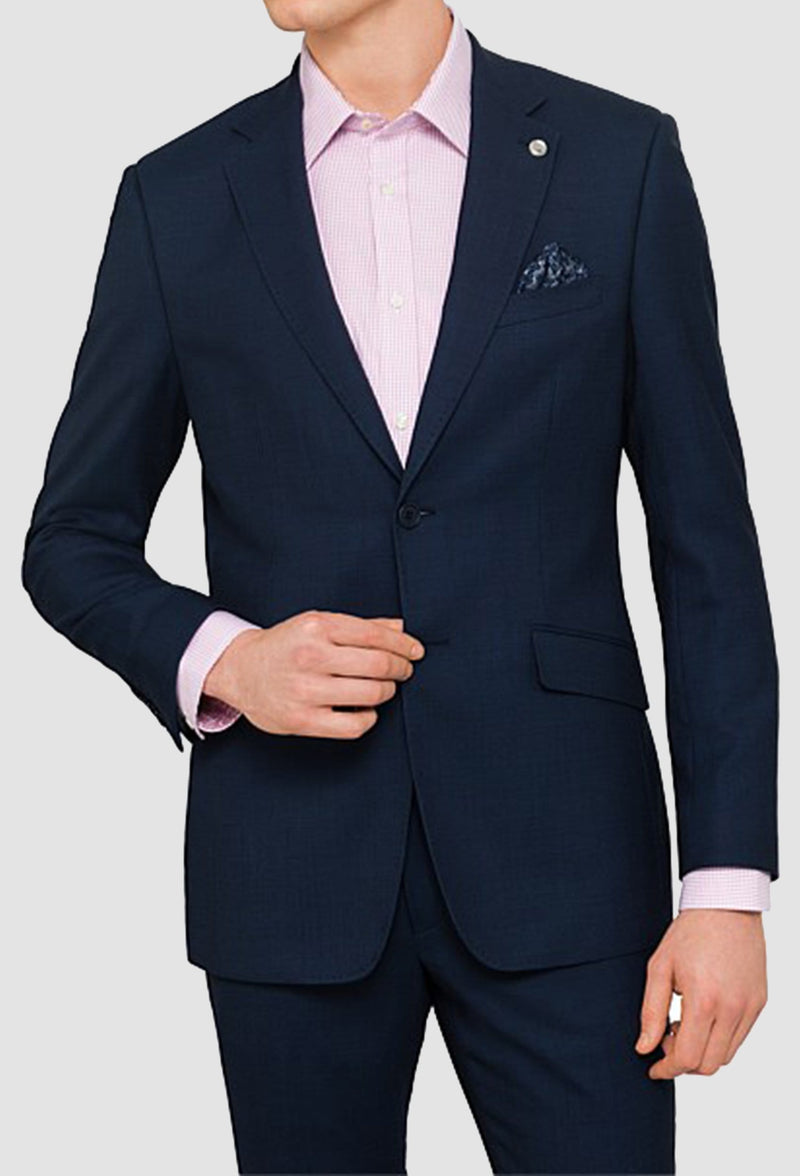 a close up front view of a model wearing the ted baker slim fit Ralph Birdseye suit in navy pure wool