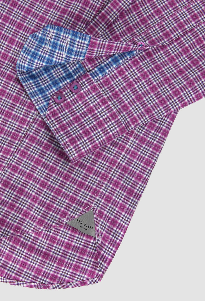 A close up view of the sleeve button detail on the Ted Baker slim fit catton shirt in pink 2RSH54