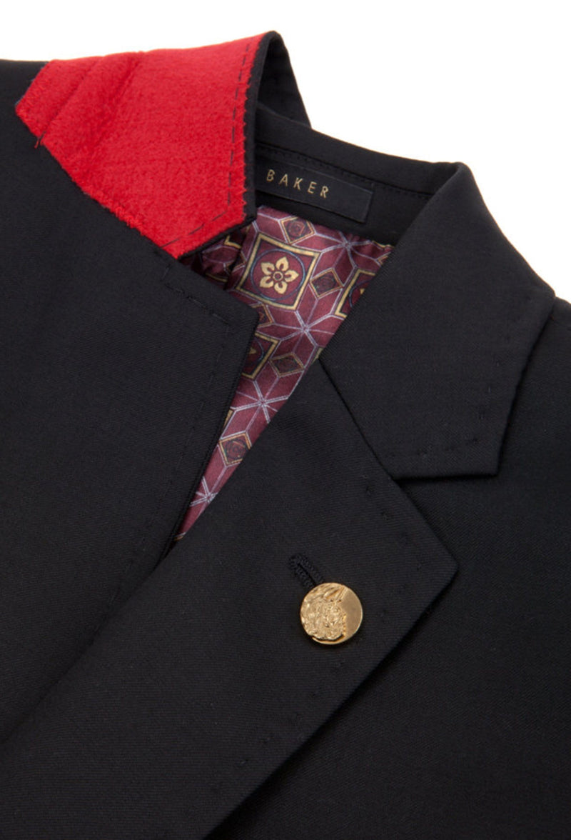 a close up view of the felt collar and gold button lapel detail on the ted baker slim fit sovereign suit jacket in black