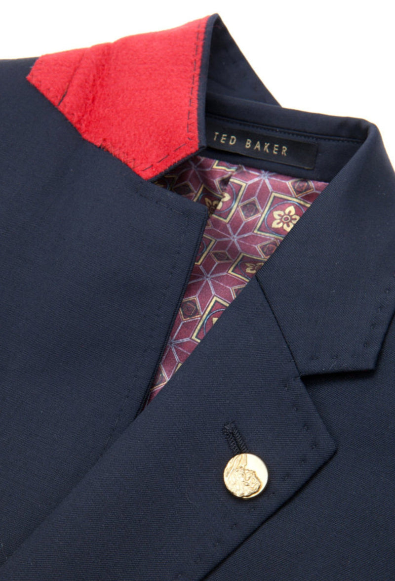 a close up view of the felt collar and lapel detailing of the a front on view of the ted baker slim fit sovereign suit jacket blazer in navy 1RL0310