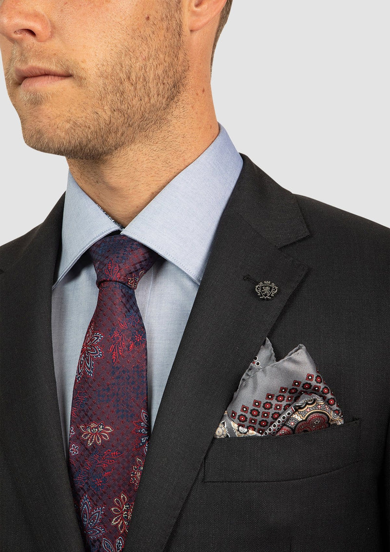 the peak lapel and front pocket detail in charcoal pure wool FCI417