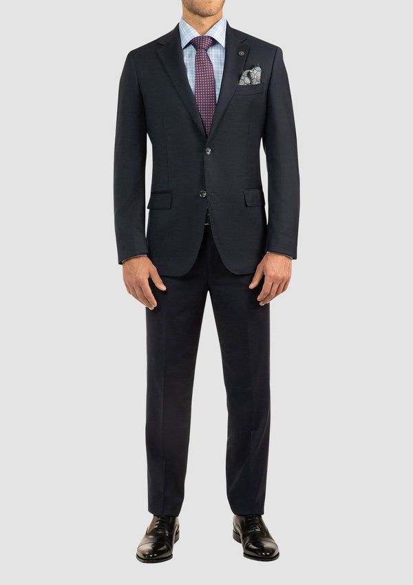 a model wears the cambridge pure wool morse mens suit in navy pure wool