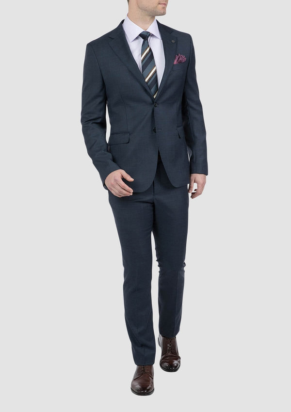 a model wears the cambridge morse suit in navy blue pure wool FCI371