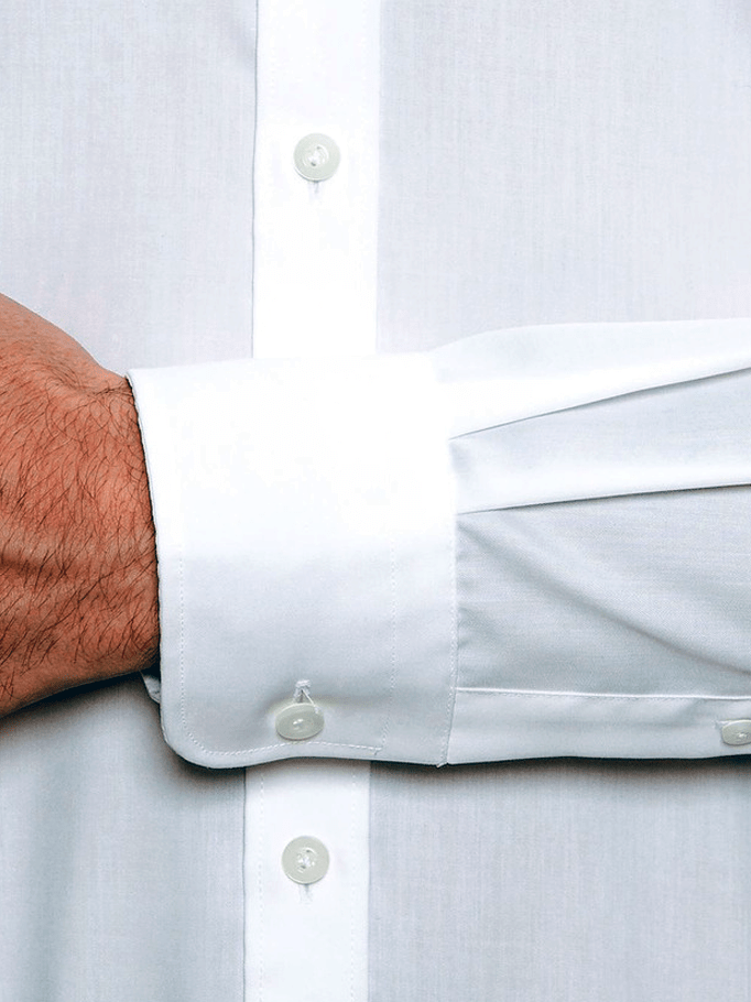 a close up of the regular cuff detail on the cambridge preston mens business shirt in white pure cotton.