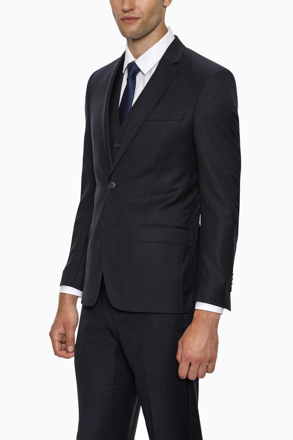 a model wears the gibson breeze suit in navy wool form mens suit warehoue