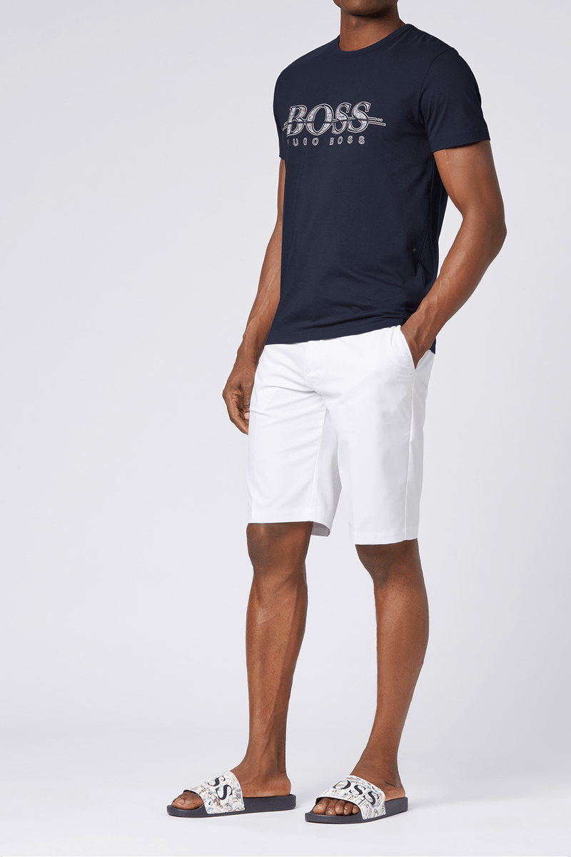 the navy hugo boss mens crew neck tshirt worn with a boss slides and white shorts