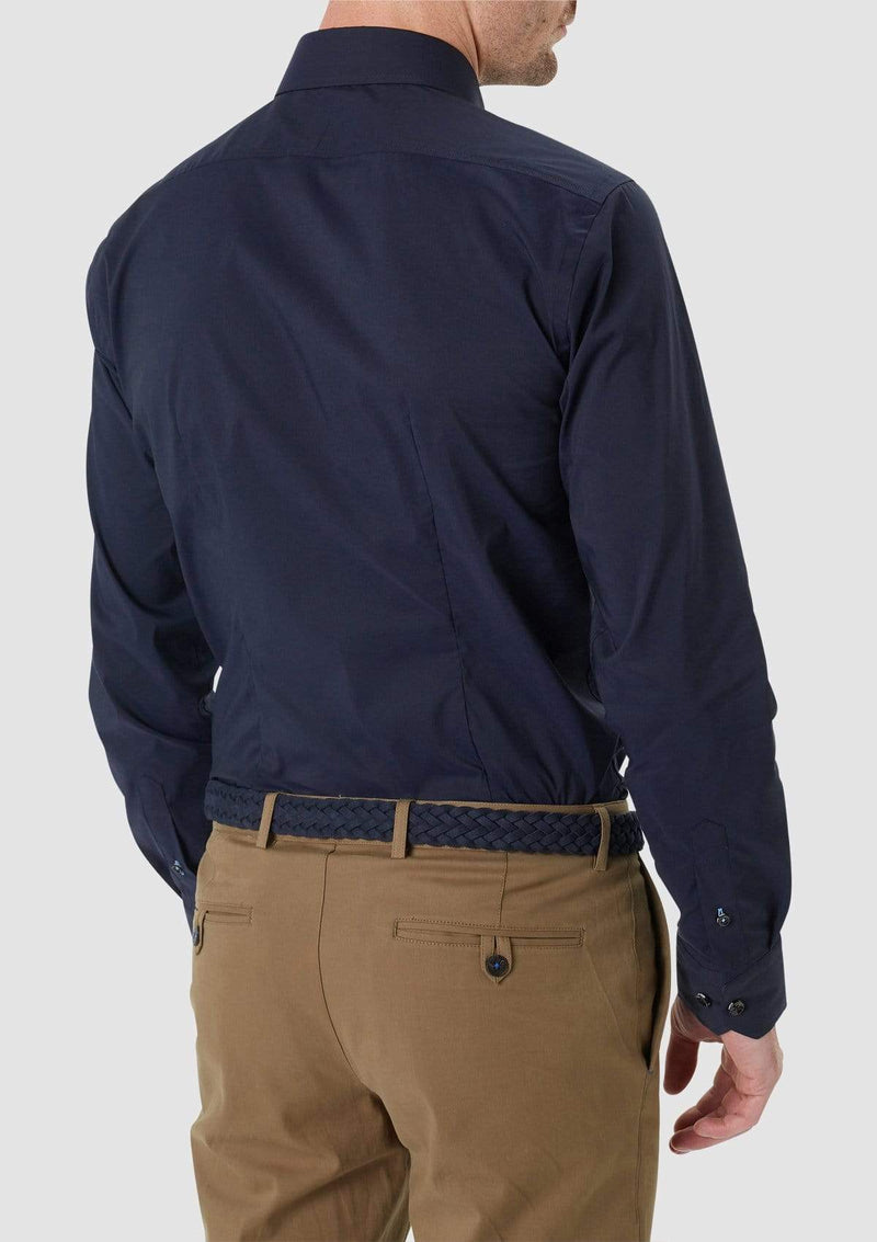 the back view of a model wearing the wolf kanat slim fit cotton stretch herve mens business shirt in navy 9WKS939