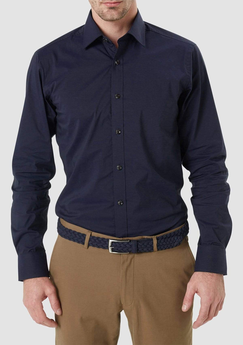 the front view of a model wearing the wolf kanat slim fit cotton stretch herve mens business shirt in navy 9WKS939