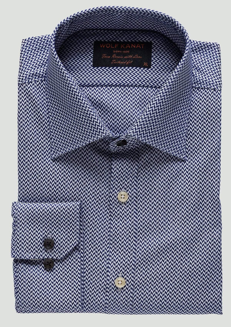 a close up on the romanov business shirt folded showing the modern collar, single cuff grey bottons and transparent buttons down the front