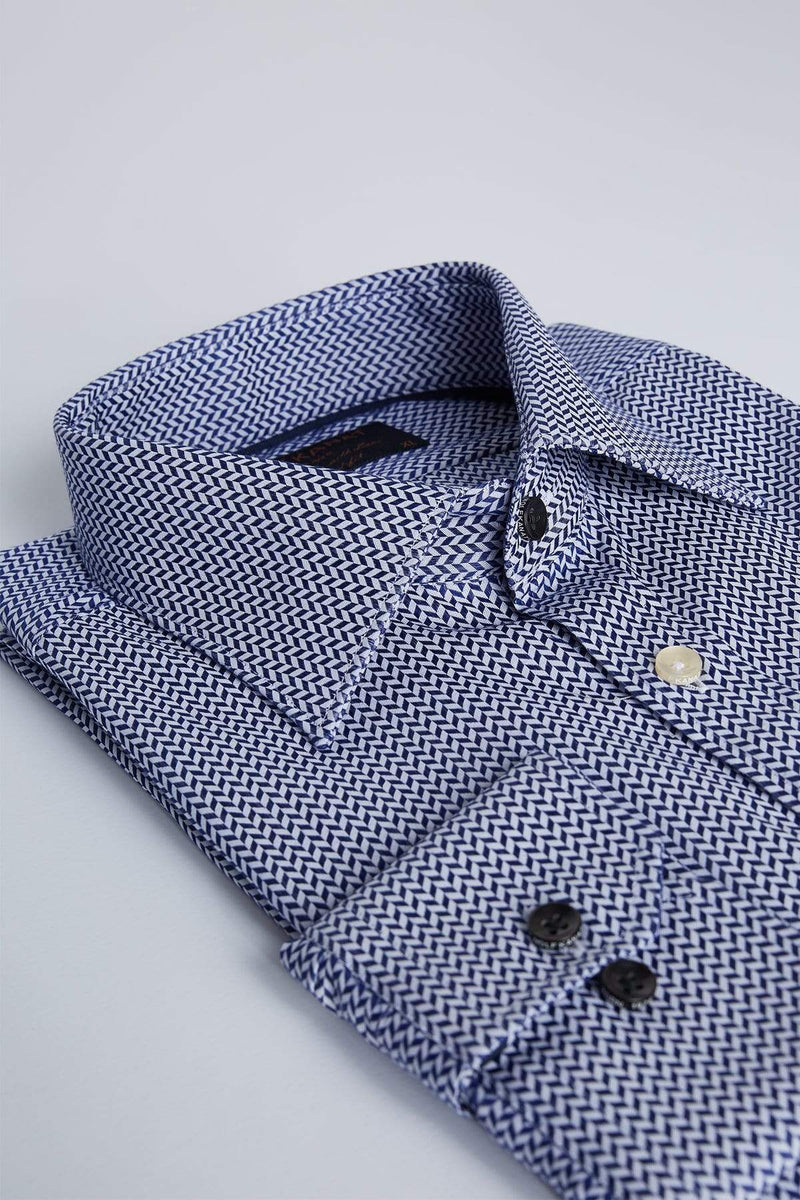 a side folded view of the wolf kanat romanov business shirt in indigo herringbone print cotton
