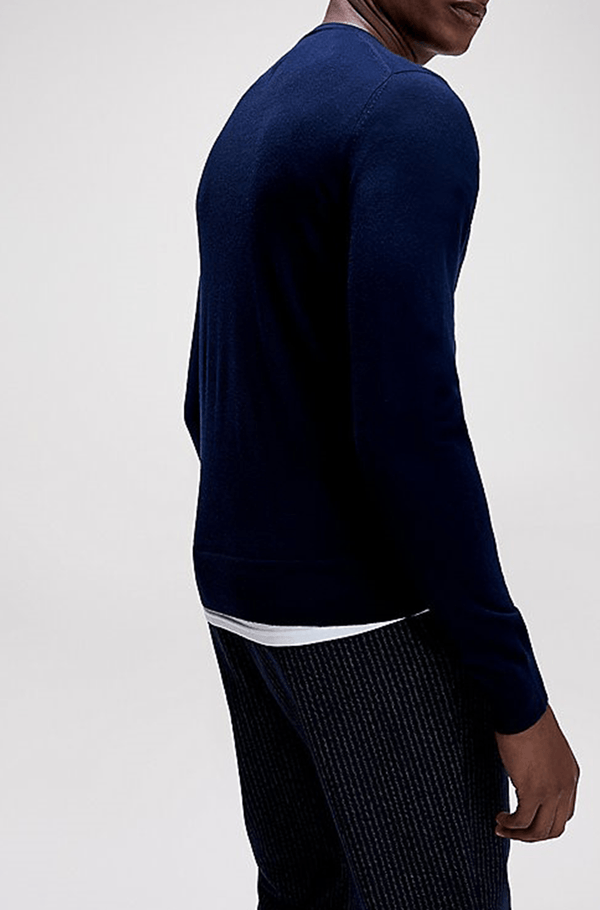 a side on view of the Tommy Hilfiger classic fit luxury wool mens crew neck jumper in navy TT0TT06521_DW5